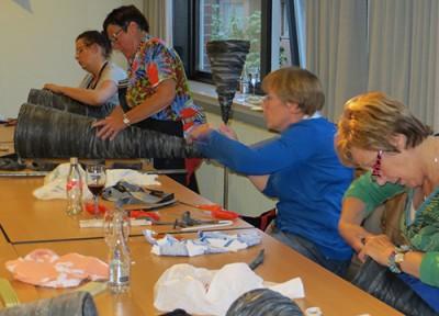 workshop tuindecoratie bloemenkegel fietsbanden Gistel